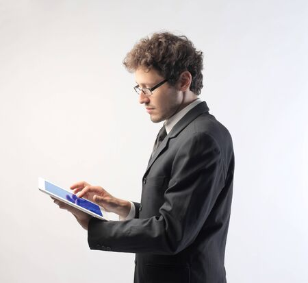 pads: Young businessman using a tablet pc