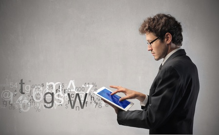 graphic tablet: Businessman using a tablet pc to communicate