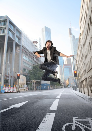 run way: Happy man jumping on a city street
