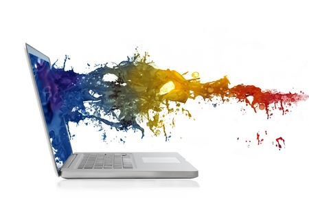objects: Colored paint coming out of the screen of a laptop Stock Photo