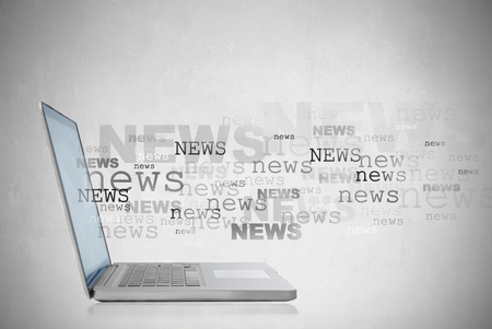 Laptop met het woord nieuws uit het scherm