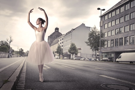 Ballerina dancing on a city street Stock Photo - 10616709