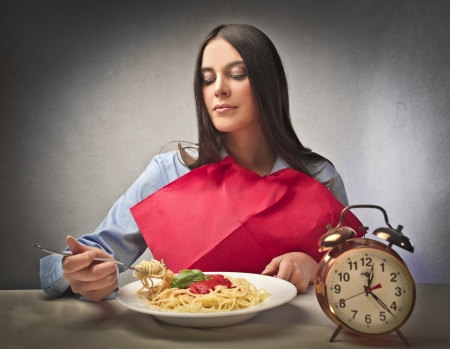 Beautiful woman eating spaghetti Stock Photo - 10637730