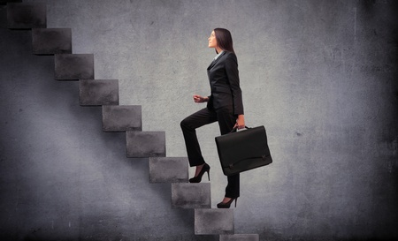 business briefcase: Businesswoman stepping up a staircase