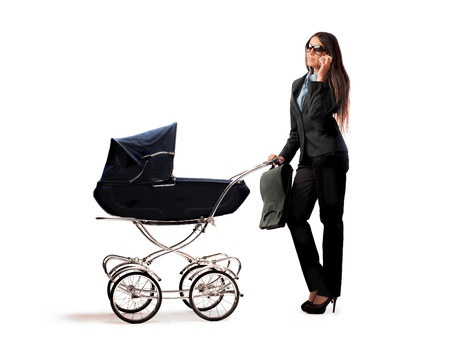 Beautiful businesswoman pushing a pram Stock Photo