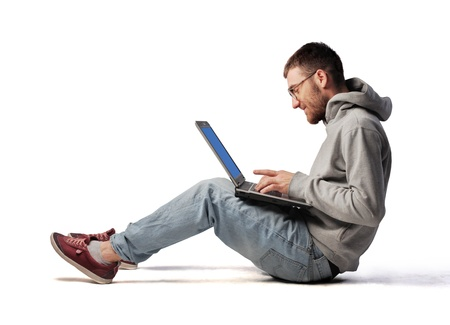 Young man using a laptop photo