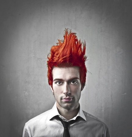 flamy: Young businessman with flamy hair up in the air Stock Photo