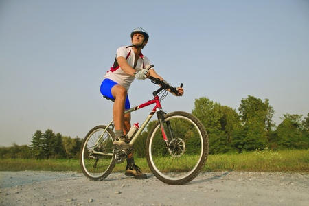 Cyclist riding on a road Stock Photo - 10802712
