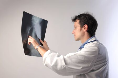 Doctor examining some x-ray slides Stock Photo - 10802715