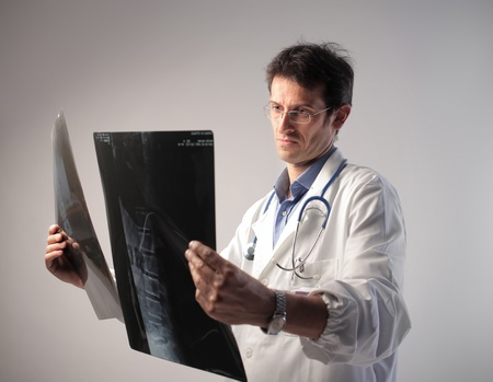 Doctor examining some x-ray slides Stock Photo - 10805109