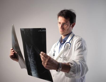 medical examination: Doctor examining some x-ray slides