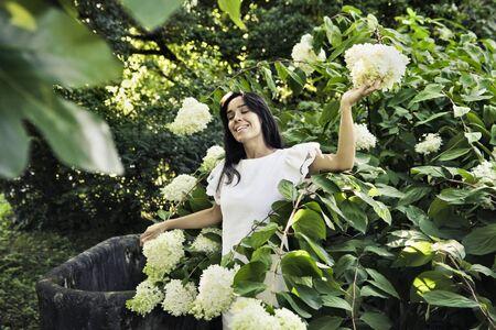 felicity: Smiling beautiful woman in a garden Stock Photo