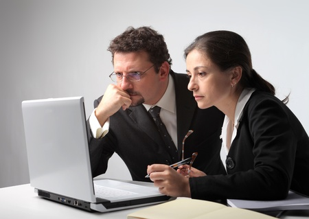 preoccupied: Couple of business people using a laptop Stock Photo