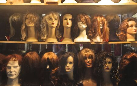 mannequin head: Show window of a wig shop Stock Photo