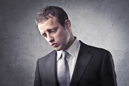 unhappy man: Sad businessman Stock Photo