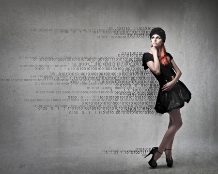 Beautiful elegant woman with numbers coming out from her clothes Stock Photo