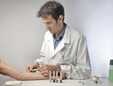 Doctor doing a blood test on a man Stock Photo - 10905192