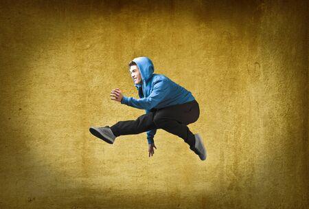 Young man jumping Stock Photo - 10916985