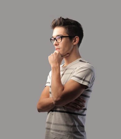 Young man with thoughtful expression Stock Photo - 10916836