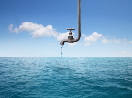 on tap: Tap dripping some water in the sea