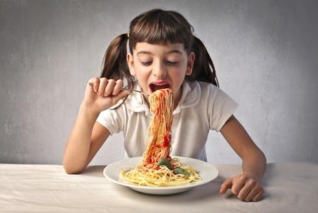 spaghetti dinner: Little girl eating spaghetti