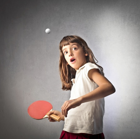 ping pong: Little girl playing ping pong