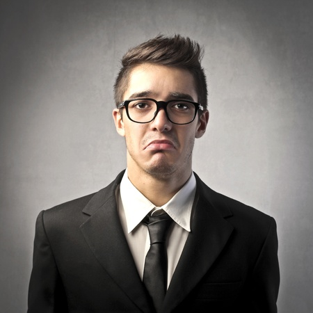 unhappy man: Businessman with sad expression
