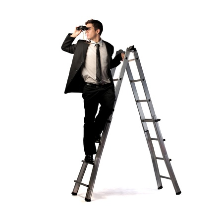 using binoculars: Businessman on a ladder using binoculars