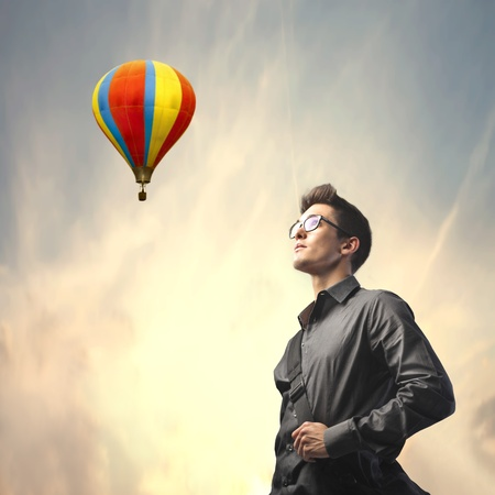 hot guy: Businessman with hot-air balloon in the background