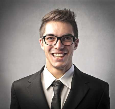 Smiling handsome young businessman photo
