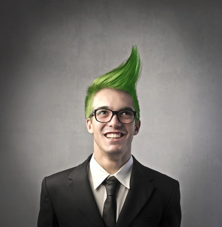 upright: Smiling businessman with green upright hairstyle