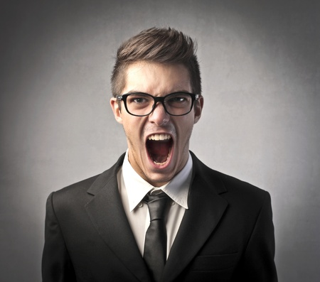 rebellion: Angry businessman shouting Stock Photo
