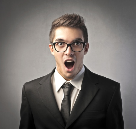 stupor: Astonished young businessman