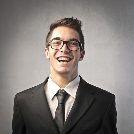 Laughing young businessman photo