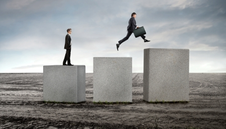 across: Businessmen on stone cubes jumping towards higher ones