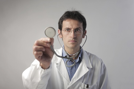 health check: Doctor holding a stethoscope Stock Photo