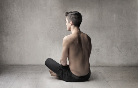 obscured: Rear view of a bare-chested young man  Stock Photo