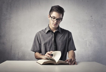 Young man reading a book Stock Photo - 11069064