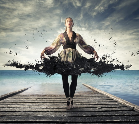 3d dance: Beautiful elegant ballerina on a pier with her dress melting in black paint Stock Photo