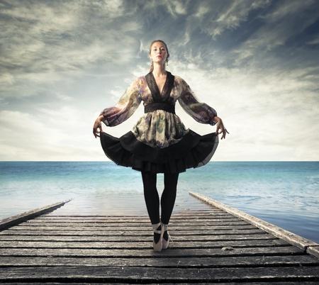 old style: Beautiful ballerina on a pier
