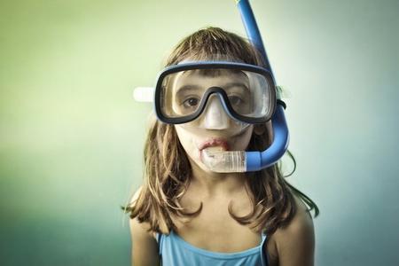 swim mask: Little girl wearing a diving mask