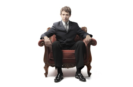 safeness: Businessman sitting on an armchair
