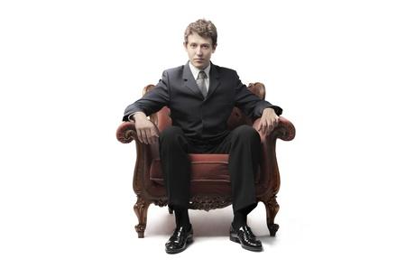 Zakenman zittend op een stoel Stockfoto
