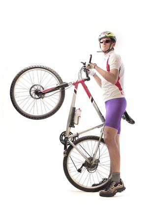 bicycle rider: Cyclist carrying a mountain bike