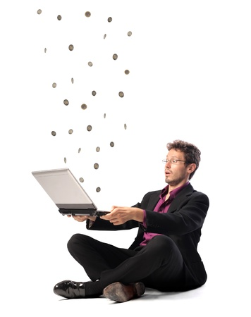 suprise: Astonished businessman with coins coming out of his laptop Stock Photo