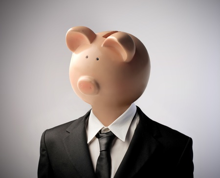 stingy: Businessman with piggy-bank instead of his head Stock Photo