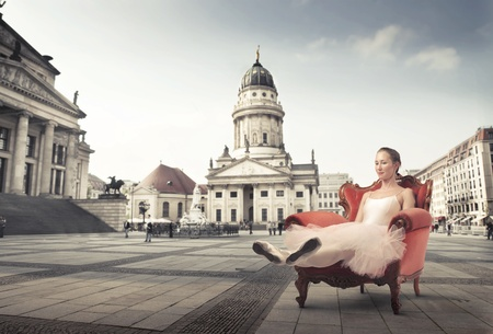 dream body: Ballerina relaxing on an armchair with museum in the background