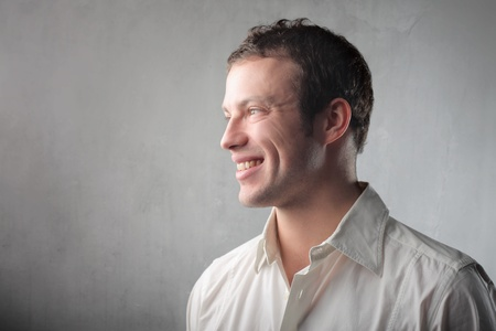 man face profile: Profile of a smiling handsome businessman