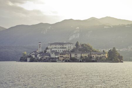 View of the island of San Giulio on Lake Orta in Italy photo