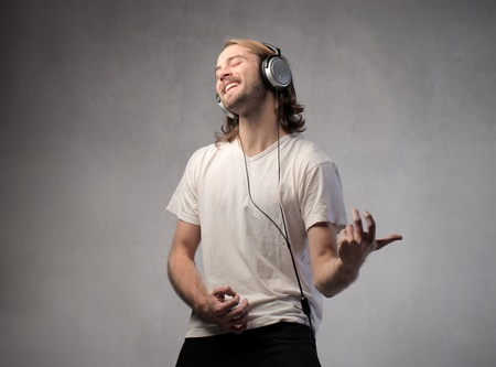 air guitar: Young man listening to music and playing an air guitar